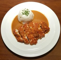 This recipe for chicken katsu curry uses tender, juicy chicken breasts that have been coated in breadcrumbs and fried until crispy, which lie on a bed of fluffy soft rice and is topped with a flavoursome, thick katsu curry sauce. Have some prawn crackers at hand and you'll feel as though you've treated yourself to a great quality takeaway!