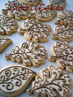 Thanksgiving / Fall cookies, maple, oak, and toothless elm leaves with decorative bronze piping - decorated iced biscuits, galletas decoradas. Leaf Cookies, Fall Cookies, Iced Cookies, Cut Out Cookies, Royal Icing Cookies, Holiday Cookies, Cupcake Cookies, Acorn Cookies, Summer Cookies