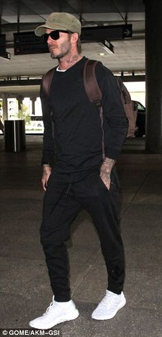 Low-key: Opting for a neutral colour scheme, David teamed a black jumper with tracksuit bottoms