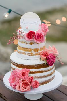 Naked cake with pink roses | Brittany and Devin Photo Co. | see more on: http://burnettsboards.com/2015/03/north-michigan-wedding-water/