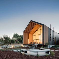 portugues architecture firm filipe saraiva arquitectos has designed a 'house-shaped' house in the farmlands of ourém, portugal.