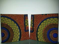 Set of 2 8x8 statement wall hangings with genuine african wax print