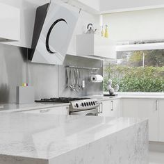 From Mexico, Cucine e Piu designed this minimalist white kitchen where OM Elica hood stands out.