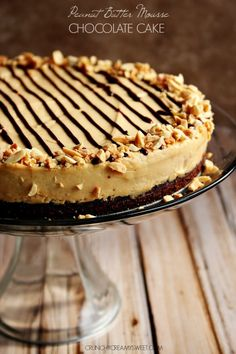 Peanut Butter Mousse Chocolate Cake - rich and moist chocolate cake with creamy peanut butter mousse that melt's in your mouth!  #recipe #peanutbutter #dessert crunchycreamysweet.com