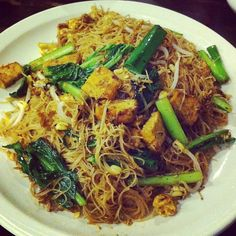 Indonesian fried thin rice noodles with vegetables, egg and tofu (bihun goreng)