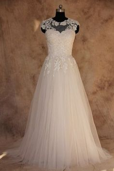 Wedding dresses with cap sleeves.  Illusion neckline Plus Size Wedding Gown.  This plus size wedding dress can be made with beaded lace or any other embellishment you like.  We have many #plussizeweddingdresses to consider.  See other designer wedding dress options at www.dariuscordell.com