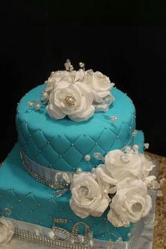 Gorgeous blue cake with white roses