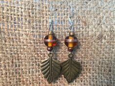 Brown Bead with Leaf Charm Earrings by Anna Dewell Designs, $8.00 USD