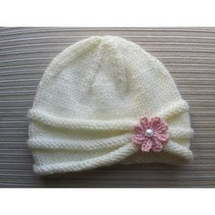 """This hat is made on straight needles and has a seam.If you would like to make it on circular needles, you would need to eliminate the 1st and the last stitches of every row as they are for the seam. Also, you would need to make necessary changes for the wrong side rows as they will be on the right side when working in the round.Gauge:4 sts, 5 rows per 1"""" on U.S. #9 needles4.5 sts, 6 rows per 1"""" on U.S. #7 needlesFinished Measurements:Hat Circumference: 15.75"""" (17"""") relaxedHat Depth: 6.25""""(…"""