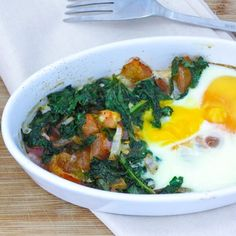 Baked Eggs with Sauteed Kale :: Pre heat oven to 180° Heat olive oil in a fry pan and add red onion and cook for 2 minutes. Add kale and tomato and cook for a further 2 minutes. Remove from pan and season with salt and pepper. Lightly grease 2 ramekin or small baking bowls. Place the kale mixture onto one half of each of the ramekins, then crack 2 eggs into each ramekin. // Full recipe @ http://naturalfertilitybreakthrough.com/food-nutrition/meal-plans-recipes/baked-eggs-with-sauteed-kale/