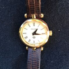 Vintage Gucci watch marking it down ladies Authentic Vintage ladies Gucci watch! Took to a jeweler for authenticity, Original Genuine leather strap with a few flaws, otherwise in good condition.it was my grandmothers, cleaned out her house and found lots of old stuff, no box or certificate wouldn't even know where it is! She is in a home and has no clue who she is so we are selling everything to afford her care! It's a neat watch from the 70's it just needs a new battery! Gucci Accessories…