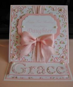 beautiful handmade card ... peachy pink and cream ... luv the die cut word GRACE cut from patterned paper ... sweet die cut corner embellishments and labels ... perfect satin bow  ... pearls ... easel card ...