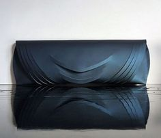 Linda Sieto is a designer from Budapest who creates handbags and clutch that melt fashion, art and design. Her creations are all unique pieces, with minimalist and futuristic shapes. ...