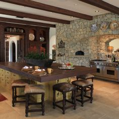 Spanish Colonial Home - love the leather/cowhide stools