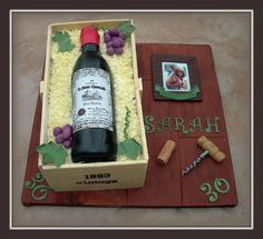 Red wine bottle in a crate cake