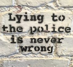 """This photograph was taken at the Banksy exhibit at the Moco Museum in Amsterdam, Netherlands. It reads """"Lying to the police is never wrong."""" This symbolizes rebellion against authority and government."""