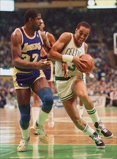 Magic Johnson and Dennis Johnson (Boston Celtics)