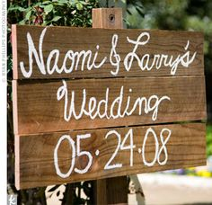 There were plenty of personal touches on hand too: A rustic hand-painted wooden sign made by the couple's friend directed guests to the party area.