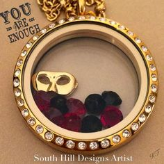 South Hill Designs large gold locket with gold mask, red and black crystals. By artist Kristin Fuller