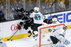 San Jose Sharks defenseman Scott Hannan pins Los Angeles Kings forward Dustin Brown to the boards (Oct. 8, 2014).