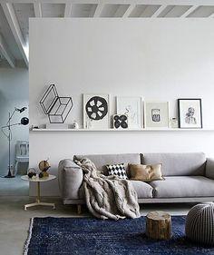 Scandinavian living room with poufs