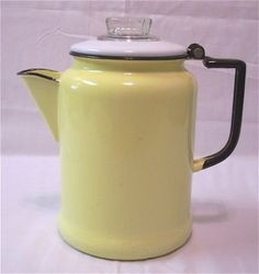Fantastic yellow and black enamel ware coffee or tea pot.   In overall good condition with 4 chips on the bottom edge, and one small chip near the spout.  No strainer.  5 inches in diameter at the base, and 8.25 inches tall.      If outside the U.S. please email me for shipping quote. Thanks!