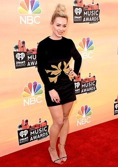 Hilary Duff wears a black Maria Lucia Hohan dress with Giuseppe Zanotti heels at the 2014 iHeartRadio Music Awards