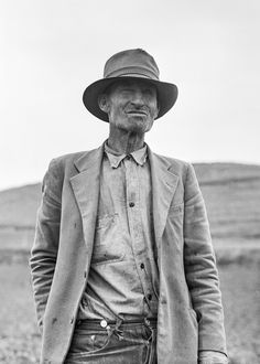 """1936. """"This man is a labor contractor in the pea fields of California. 'One-Eye' San Luis Obispo County, California."""" Photograph by Dorothea Lange"""