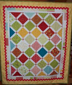 love this simple on point quilt and I have been looking for a way to incorporate rick rack!