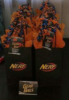 Nerf Birthday Party #Party Favor Bags Nerf logo cut out and pop dotted onto bags found at Michael\'s.