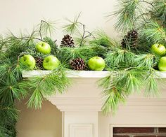 Green apples and pine cones to decorate your fireplace mantel. Nice!
