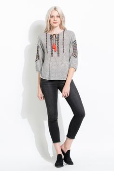 Love the embroidery and the colorful tassel! The perfect bohemian top by THML for transitioning into spring.