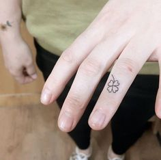Tiny four leaf clover tattoo on finger by Chaewa