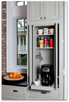 Love this coffee cabinet! I would love to have that water faucet in a small 'coffee' cabinet away from the sink! New Kitchen, Kitchen Decor, Kitchen Interior, Hidden Kitchen, Kitchen Modern, Kitchen Corner, Awesome Kitchen, Kitchen Small, Corner Sink