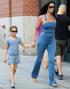 Denim darlings: Padma Lakshmi showed off her incredible physique in skintight overalls and no shirt while going out to dinner with her daughter Krishna, five