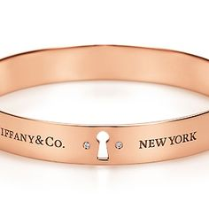"Tiffany Locks bangle: Bangle in 18k rose gold with round brilliant diamonds, engraved with the Tiffany logo. Medium, fits wrists up to 6.25"" in circumference."