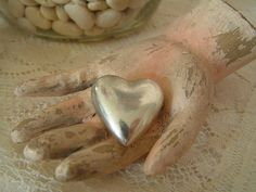 "silver heart in wooden hand (CREEPY...my first thought when I looked at this was, ""Oh look, Thing has stolen the Tin Man's heart..."")"