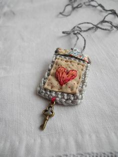 Inspiration :: Liberty fabric with embroidered heart, crochet, small key charm