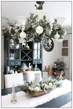 Beautiful farmhouse Christmas dining room with a snowy, winter wonderland feel. … Beautiful farmhouse Christmas dining room with a snowy, winter wonderland feel. Decorated in white, greens, and metallics for that magical Christmas look. Christmas Room, Magical Christmas, Christmas Holidays, Christmas Kitchen, Christmas Ideas, Apartment Christmas, Christmas Island, Christmas Music, Christmas Gifts