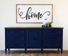 This sleek deep navy blue media console features 7 dovetailed drawers, 2 shelves, rubbed bronze hardware and a dark walnut farmhouse top. What a statement! The door is perfect to hide electronics when needed. The custom finish was sprayed on for a smooth even finish, lightly distressed and sealed for extra durability. Would be great as an entryway table, dresser, dining room buffet, or changing table. Measures: 72 long x 18 deep x 32.5 tall Located in Tucson, Az LOCAL PICKUP: Free local…