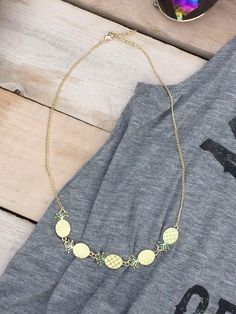 """Sweet enamel pineapples suspend from a golden chain. Secures with a lobster claw clasp. 16"""" + 2"""" extender."""