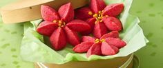 Bring festive color to your dessert table with beautiful cookies the resemble poinsettia blossoms.