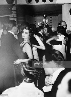 Princess Alexis Mdivani, the former Barbara Hutton, heiress to the Woolworth Millions, dancing with one of her guests at a party celebrating her birthday at the Ritz Hotel in Paris. The all night party of pre-depression splendor, the cost of which was estimated at more than $10,000, spread through the Tea Room, dining room and ballroom of the hotel which was transformed into a reproduction of a Moroccan street. An orchestra, entertainers, and some of the 129 guests were flown to the party…