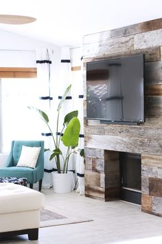 By popular request, here is the DIY tutorial for my reclaimed wood fireplace. I am so excited to show you this project that I think absolutely makes the living room. And besides, don't you love a great before + after?! Let me start by saying this was our first attempt doing something like th