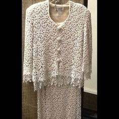 """LILY BUTLER....2 pc. lace....STUNNING! Size long skirt with jacket, completely lined. Excellent condition! Beautiful one of a kind suit. Possible Mother of the Bride/Groom? Wedding? I cant say enough about this outfit! Skirt measures approx. 30"""" at waist with zipper up back to close. Length of skirt Approx 43"""", lining 38"""" . Jacket sleeves measure Approx. 20"""" from shoulder to end of lace. lining of sleeve measures approx. 15"""". There is two layers of lace at sleeves adding an extra 5"""". Jacket…"""