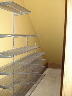 The pesky under-the-stairs closet so may of us have. ELFA wall-mounted standards with deep shelving does the trick! The pesky under-the-stairs closet so may of us have. Dana Ka Flur The pesky under-the Stairway Storage, Hallway Storage, Basement Storage, Basement Stairs, Closet Storage, Basement Remodeling, Under Stairs Pantry, Deep Closet, Hall Closet