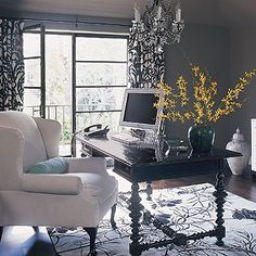 Chic gray office with charcoal gray walls, black colonial office desk, upholstered wing back desk chair, crystal chandelier, black damask drapes panels and white black patterned rug! Gray office. Gray paint wall color. black gray white gold turquoise blue yellow green office colors.