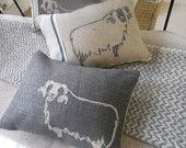hand printed charcoal sheep cushion.  love the understated designs by helkatdesign on Etsy