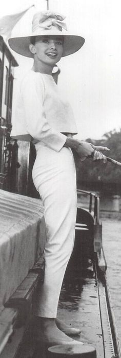 Audrey Hepburn 60s sportswear day outfit pants cropped shirt hat pencil cigarette white vintage fashion modern looks