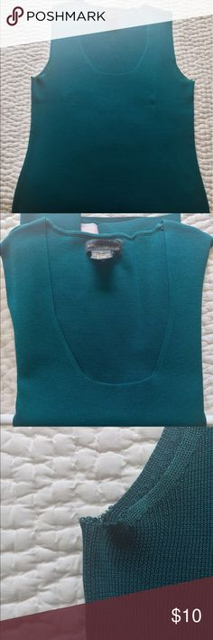 Teal silk tank top from Banana 🍌 Beautifully soft silk tank top from BR.  Great layering piece under a jacket, or it can be worn alone.  Slight fraying at the underarms so I will take less for this piece.  It's still in good shape. I want to honest with my Posh peeps, though! Banana Republic Tops Tank Tops
